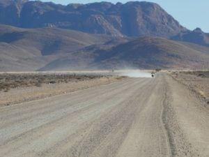 rs-p1000835-bike-on-road-dust